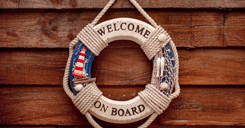 Welcome On Board sign hanging on a wall